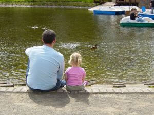 dad and daughter by water