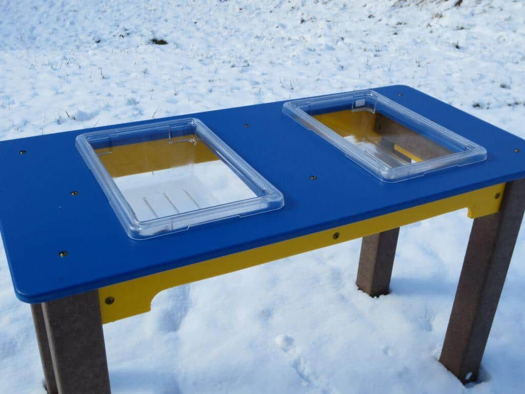 Sensory table on playground in snow