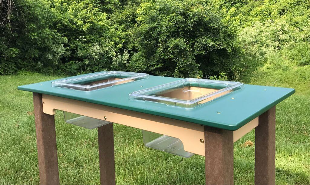 Sensory Table with Removable Bins Sitting in Grass